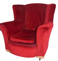 Early 20th century armchair, red upholstery with loose seat cushion, set on casters, 83cm high