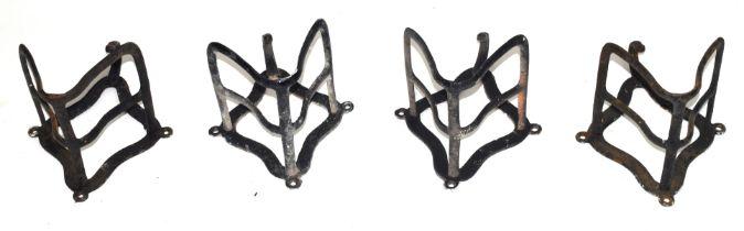 Four Victorian iron saddle racks, approx 30cm high