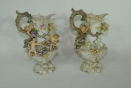 Two Continental porcelain vases decorated in relief with cherubs and floral encrustations