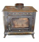 20th century cast iron wood burning stove by Sunrain, with glazed single door, 70cm high max
