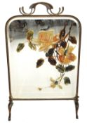 Early 20th century brass framed fire screen with central bevelled mirror with overpainted rose