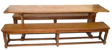 Early 20th century oak refectory style dining table with plank top over tapering side supports and a