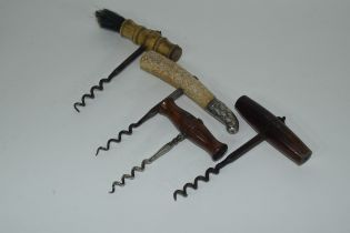 Quantity of corkscrews including one with silver top, one with bone handle