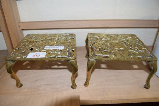 TWO SMALL BRASS FOUR LEGGED TRIVETS BEARING ROYAL COAT OF ARMS
