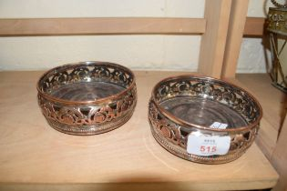 PAIR OF SILVER PLATE ON COPPER BOTTLE STANDS