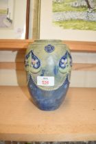 ROYAL DOULTON STONEWARE VASE DECORATED WITH TUBE LINED AND BEADED FLORAL DETAIL