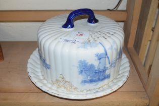 BLUE AND WHITE CHEESE DOME DECORATED WITH WINDMILLS