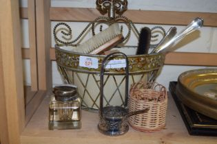 SMALL WALL MOUNTED BASKET CONTAINING VARIOUS ASSORTED BRUSHES, GLASS PAPERWEIGHTS, SILVER PLATED