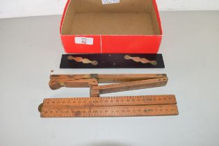 THREE VINTAGE FOLDING WOODEN RULERS