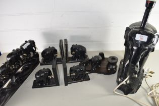 COLLECTION OF HARDWOOD EBONY ELEPHANTS COMPRISING TWO PAIRS OF BOOKENDS, FAMILY OF FIVE ELEPHANTS