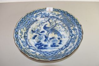 JAPANESE BLUE AND WHITE PLATE DECORATED WITH A PEACOCK