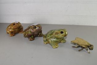 MIXED LOT COMPRISING A BRASS MODEL FLY, THREE POTTERY MODEL TOADS (4)