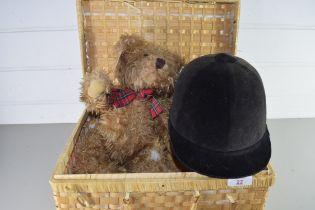 BASKET CONTAINING A TEDDY BEAR AND A RIDING HELMET