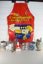 MIXED LOT COMPRISING BEER STEINS, SNOOPY MONEY BOX AND A SNOOPY APRON PLUS OTHER ITEMS