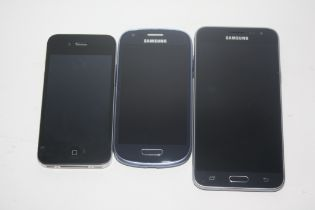 I-phone and a pair of Samsung phones