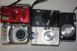Mixed lot of cameras to include a Nikon Coolpix X6200 and Canon digital Ixus