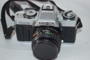 Minolta XG-M film camera together with Rokkor 50mm lens