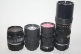 Canon EFS 18-55mm lens, a Voigtlander 75mm lens, a Helios lens, an Optomax 85-205mm lens