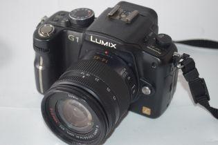 Panasonic Lumix DMCG1 with Lumix 14-15 lens, and Lumix 145-175 lens plus charger and case