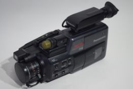 Panasonic MC6 camcorder and accessories, in hard case, with manual