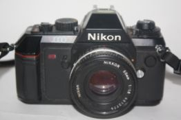 Nikon N2000 film camera together with a Nikkor 50mm lens and flashes