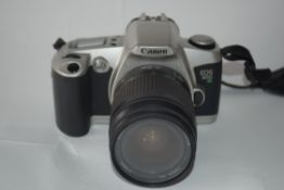 Canon EOS 500N film camera with manual and case together with Canon zoom lens EF28-80mm