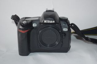 Nikon D70 camera with flash leads and manual