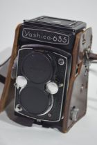 Yashica-635 35mm film camera together with manual, slide, copier, Prinzflex 3 x autoconverter and