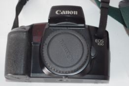 Canon EOS100 film camera together with Canon zoom lens EF28-105mm and case