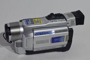 JVC Mini DV digital video camera with leads and a bag