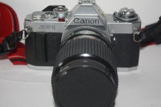 Canon AV-1 together with Sirius MC autozoom 28-70mm lens