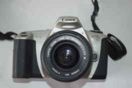 Canon EOS300 together with Canon zoom lens 35-80mm, in bag