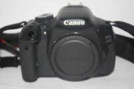 Canon EOS 60D together with a Canon EFS 18-55mm lens and Canon lens EF50mm