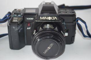 Minolta 7000 AF together with Sigma Zoom lens, bag and manual
