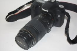 Canon EOS 50D digital camera together with Canon zoom lens EF70-300mm