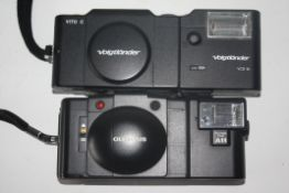 Olympus XA2 film camera together with Voigtlander Vito C film camera