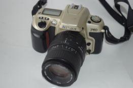 Nikon F60 film camera together with Sigma zoom 70-210mm lens, Nikon AF Nikkor 28-80mm lens and