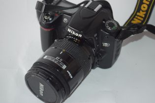 Nikon D80 together with AF Nikkor 28-85mm lens, leads and case