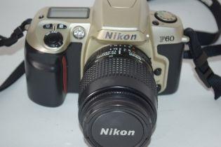 Nikon F60 film camera with film loaded, together with a Nikon AF Nikkor 35-80mm lens, manual and