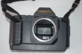 Canon T80 film camera together with Canon zoom lens, AC35-70mm plus manual