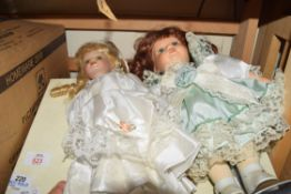 MIXED LOT COMPRISING A BOXED ALBUM TOGETHER WITH TWO PORCELAIN HEADED DOLLS