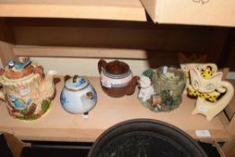 MIXED LOT VARIOUS DECORATED TEA POTS AND CAT ORNAMENTS ETC