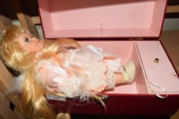 SMALL PORCELAIN HEADED DOLL AND A SMALL RED CASE
