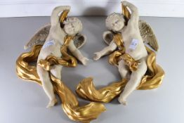 PAIR OF COMPOSITION CHERUB FORMED WALL ORNAMENTS