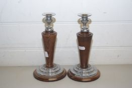 PAIR OF OAK AND CHROME MOUNTED CANDLESTICKS