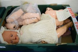 BOX OF ANTIQUE DOLL AND DOLL PARTS CIRCA 1930S
