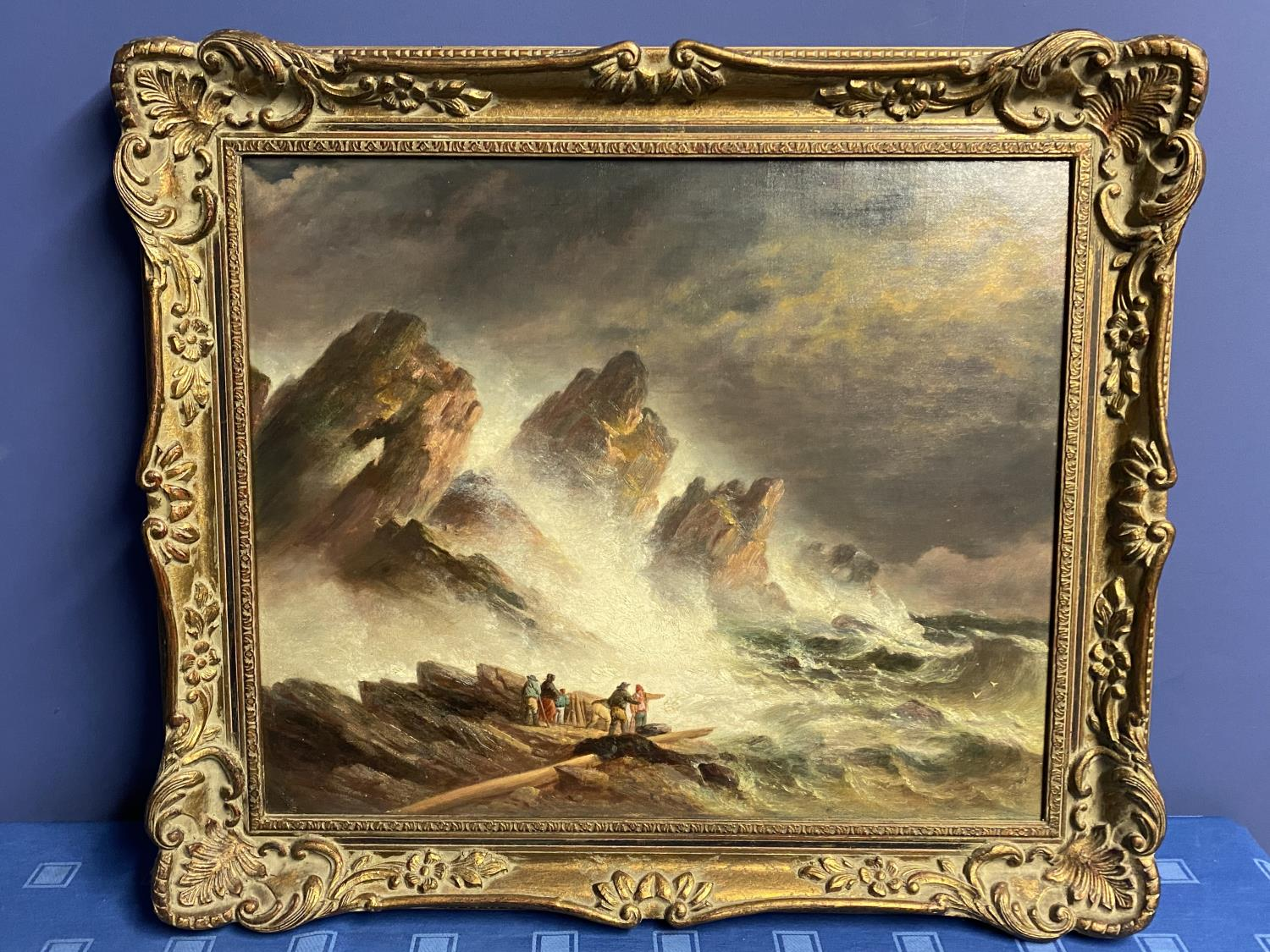 C19th oil on canvas, figures on rocks within a stormy sea, 50 x 60cm