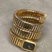 18ct gold Bulgari cocktail watch on sprung 18ct gold Bulgari strap, black face (Provenance lots 12