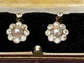 Pair of 18ct gold and platinum pearl and diamond drop earrings, central 4mm natural cultural pearl