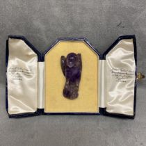 Carved amethyst model of a parrot with intagio stamp to base, in a James Ogdon and Sons fitted box,